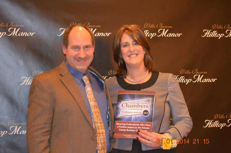 Stacey and Mark accepting 2014 Trailblazer Award