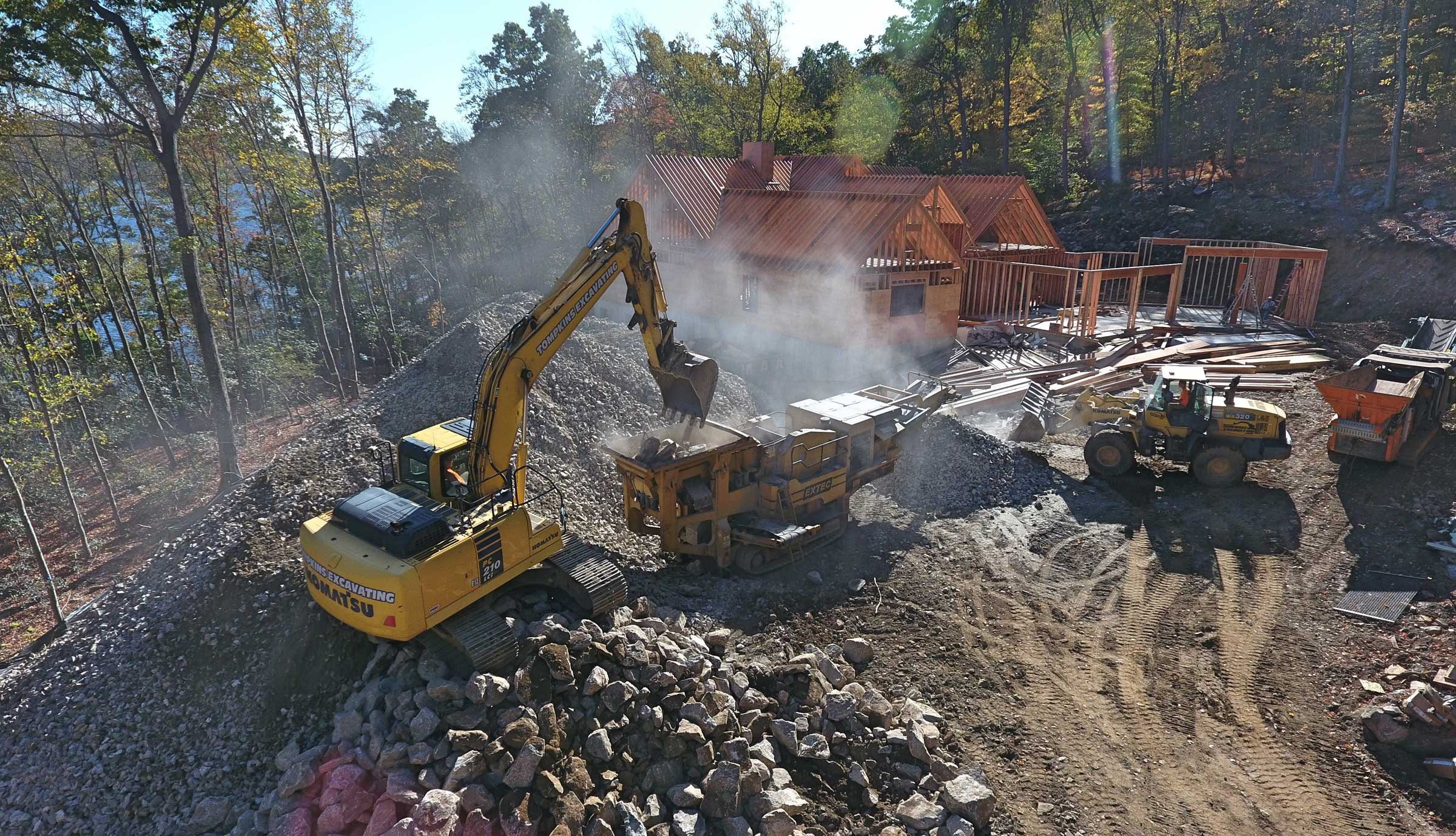 Three earth moving machines work around new residential site development.